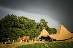Image by Samantha Ward Photography - MiaMia Bridal Wedding Dress & Mia Sposa Veil for a Rustic Tipi reception in the Countryside with Naked Caked. Bridesmaids wore bespoke blue gowns and Groomsmen in high street suits.