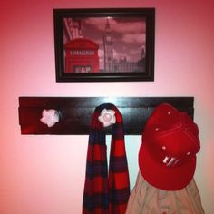 Old closet side board+old sink faucet knobs+spray paint=awesome coat rack!!! Tres magnifique!