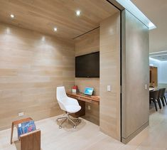 Pocket doors divide the office space from the public areas of this sleek Manhattan apartment.  Perfectly efficient.