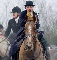 After foxhunting sidesaddle... totally badass :)