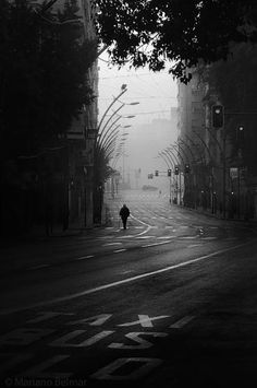 thought, oh this is lovely - framed in shadow...then noticed the letters illuminated on the street, and the entire sense of scale shifted... love... Mariano Belmar
