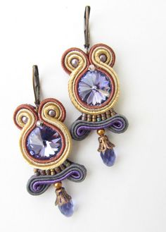 Hand made by using the following materials: soutache, Swarovski crystals, czech glass beads, japanese seed beads and metal components.  Leverbacks