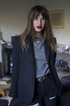 Jeanne Damas - black short with black tights, black blazer, grey jumper