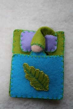 Adorable felt gnome in a wee felt bed. All hand stitched.