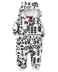 Super soft and cozy, this zip-up printed fleece jumpsuit keeps her warm from dusk to dawn. Ribbed cuffs, a kanga pocket and a velboa-lined hood complete this adorable look.