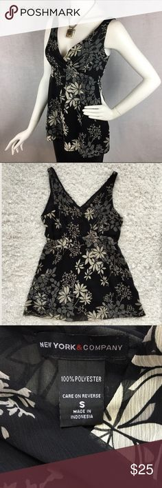 Pretty NY&Co babydoll print top Pretty v-neck double layer top with gray, tan and cream floral print. Has empire elastic gathering under bust for a flattering fit. Deep v-neck. Good condition. ❗Please read my recently updated 'about me and my closet' listing for pricing/policies. New York & Company Tops