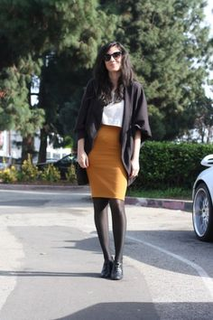 Mustard, white top, black cardigan, tights and booties