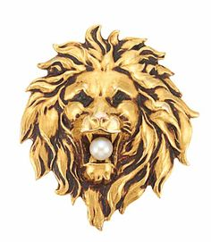 A gold and pearl brooch in the form of a lion, symbol of strength, and of the zodiacal sign of Leo.