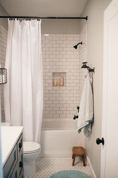 white subway tile bathroom                                                                                                                                                      More