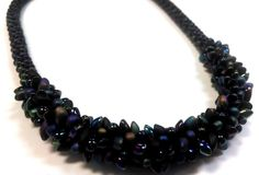 http://www.guidepatterns.com/wp-content/uploads/2015/01/Kumihimo-Necklace.jpg