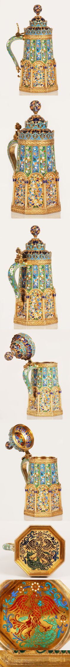 A Russian  gilded silver , multi-color cloisonne and plique-a-jour enamel tankard by Pavel Ovchinnikov, Moscow, circa 1889. Of octagonal form, the body extensively decorated with enameled scrolling floiage, the domed lid pierced and filled with vibranly colored plique enamel, the base exquisitely finished with plique enamel scene of an eagle fighting a dragon.