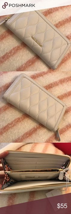 NWT Vera Bradley Quilted Georgia Wallet in White NWT Vera Bradley Quilted Georgia Wallet in White. Gold Hardware. New; Never used. Perfect Condition. Vera Bradley Accessories Key & Card Holders