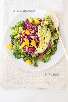 Groovy Rainbow Salad - Bueno Vida - 2c finely shredded purple cabbage, 1/2c shredded carrots, 1/2 mango cubed, lime juice, 1-2Tbsp olive oil. Serve over bed of lettuce. Top with black sesame seeds and toasted pepitas