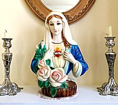Large Lighted Vintage Virgin Mary Immaculate Heart Statue (Image1)Old handpainted Virgin Mary light statue, good vintage condition with minor paint loss. BEAUTIFUL FACE w/ serene blue eyes!! In Working order!! Ceramic or chalkware.. The Blessed Mother surrounded by pale pink roses.