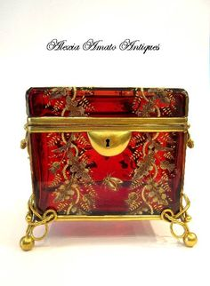 Stunning MOSER 19th Century Rich Ruby Red Casket enameled with acorn leaves and butterflies. Moser realized that using `trademark` designs other than a signature would be of tremendous importance to clients who wanted to show off their Moser glass in a showy yet discrete manner.He did this by using recognizable Moser designs such as such polychrome enameled oak leaves, birds and butterflies, enameled bugs and applied glass acorns and grapes.