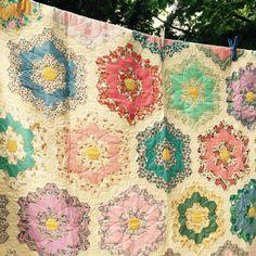 Beautiful Grandmother's Garden #hexies quilt using #vintagefabric on display at #blackcreekpioneervillage