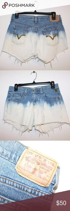 Vintage Distressed Bleached Studded Levi's Shorts These shorts have been bleached, distressed, and studded. Size 4 M. Perfect for a festival or rave! There is a tear on the front of the left leg. Levi's Shorts Jean Shorts