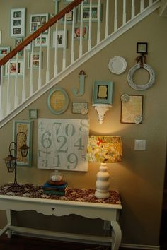 great stair decor idea Something like this would be cute in the main entrance of the house