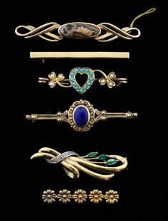 Gold brooches, a Victorian heart brooch set with pearl and turquoise, a lapis lazuli set brooch, another set with emeralds and three others