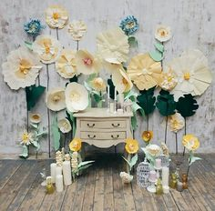 Paper flowers would make an eye-catching backdrop at a spring craft fair.