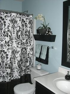 think I would do a different shower curtain though....bathroom decor idea for an ugly all white apartment bathroom