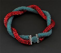 Bracelet by manganic on deviantART. I suspect this is bead crochet with a mag clasp hidden in the blue ball.