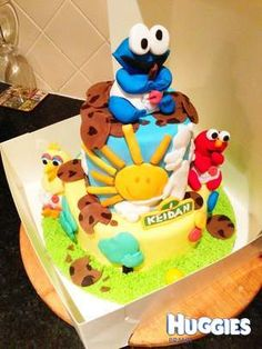 choc mudcake With choc ganache and edible 3d sesame street characters all hand made. the edible characters have been dried out and we are keeping them =)