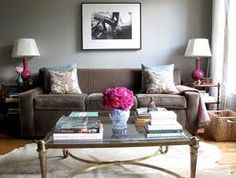 Brown Gray And Fusha Pink Are The Main Colors Used In This Living Room