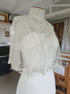 Exquisite bridal beaded capelet to transform your look. All our beading is designed and beaded for us exclusively. #beadedcapelet #bridalcapelet