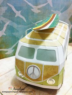 "Angeline customizes her German Bus from SURF SHACK SVG KIT by adding a rack to hold a surf board, cool dude! Create your own ""splash"" with this fabulous gift box for someone special or just make it to display! Vw Bus, Volkswagen, Silhouette Cameo Projects, Silhouette Studio, Paper Purse, Rena, Pop Up Box Cards, Surf Shack, 3d Paper Crafts"