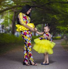 Women bold fashion statement African print dress style designed by Cameroonian fashion designer Claude Kameni of LaviebyCK campaign African Fashion Ankara, Latest African Fashion Dresses, African Print Fashion, African Men, Mother Daughter Matching Outfits, Mother Daughter Fashion, African Dresses For Kids, African Print Dresses, Beautiful Ankara Styles