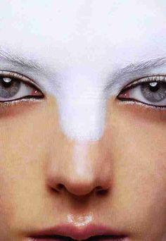 Gray eyes, white trickling into them as the transformation began.