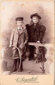 Vintage cabinet card of two Germabn children with toys