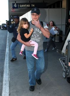 """Matt Damon & family touched down at LAX airport in Los Angeles, California (January 3, 2013). """"The Bourne Identity"""" star toted his lovely little girl Stella, 2, as they made their way through the terminal."""