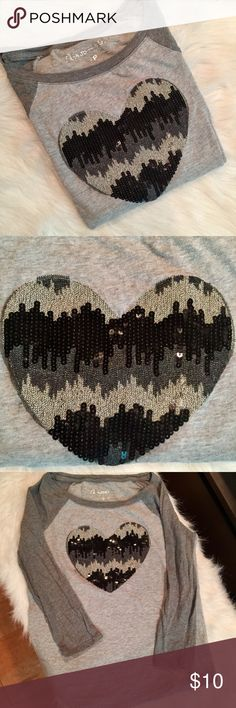 Aeropostale Grey Heart Baseball Shirt Such a cute top and in good condition, just some pilling under the arm areas. Looks cute with a puff vest! Cleaning out my closet, so grab now! Aeropostale Tops Tees - Long Sleeve