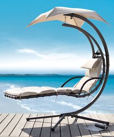 What do you think of this outdoor swing lounge with built-in umbrella? #furniture #funky