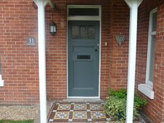 Newly painted front door - Farrow and Ball downpipe