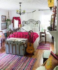 beautiful eclectic vintage boho bedroom- love the bright bold colors and white walls- Far Above Rubies: Eclectically Fall Home Tour