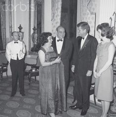 President Kennedy and Puerto Rican Governor Marin President Kennedy and the First Lady meet with Puerto Rican Governor Luis Munoz Marin and his wife at La Forteleza, the governor's mansion. Date Photographed:December 15, 1961.✾❤✽❤✽❤✽❤✾ http://en.wikipedia.org/wiki/John_F._Kennedy http://en.wikipedia.org/wiki/Jacqueline_Kennedy_Onassis