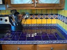 tiles Countertops blue yellow mexican tiles kitchen countertop and backsplash design ideas Kitchen Counter Tile, Mexican Tile Kitchen, Mexican Kitchens, Mexican Tiles, Spanish Kitchen Decor, Yellow Kitchen Walls, Yellow Walls, Yellow Tile, Blue Yellow