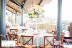 Full view of the table and centerpiece. Wood chairs with white lace linens and winery in the background. @megperotti #rustic Thomas Fogarty Winery