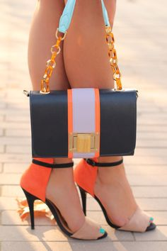 Orange and black Colors. of cute high heel sandals / shoes and handbag