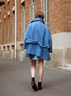 Oversized coat and bare legs.