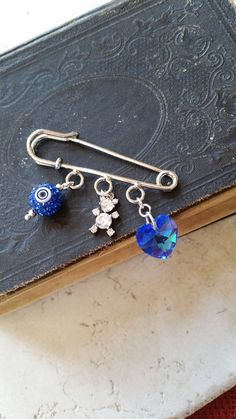 Hey, I found this really awesome Etsy listing at https://www.etsy.com/listing/209557176/handmade-safety-pin-baby-gift-stroller