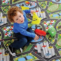 The Traffic playmat follows a fabulous maze of roads that circle through park lands and football grounds, leading to city centres, airports, housing estates and helipads. Bright and colourful, the mat will help protect floors and carpets from damage and spills and little boys will love the design. Made from PVC the mat is bound in red. Airports, Lorraine, Maze, Household Items, Roads, Little Boys, Carpets, Floors, Sewing Crafts
