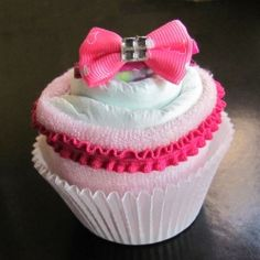 This Squidoo lens has the coolest step by step instructions for a DIY diaper cupcake. For those who can't think of what to bring to a baby shower, or who don't have time for making an entire tiered diaper cake, these are a great idea.