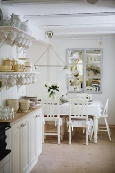 Nostalgic Inspiration for The Kitchen - love the mirror at the end of the room