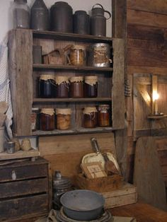 this rooms is so cozy to me, love the collection of tins and jars....