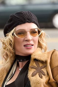 Uma Thurman in Be Cool. I love hats! and glasses too!