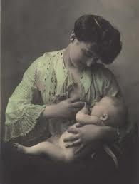 vintage mother breastfeeding - love the use of her hand and the look on her face!